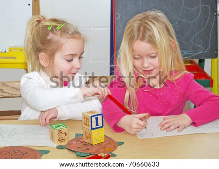 two preschoolers at work - stock photo