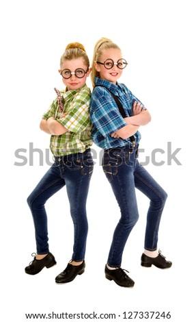 Two preteen buddies in tap dancing nerd duet - stock photo