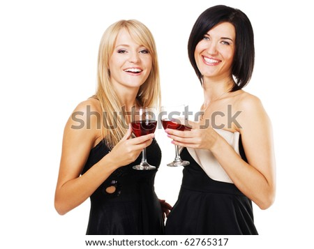 Two pretty cheerful women with glasses of wine, white bzckground - stock photo
