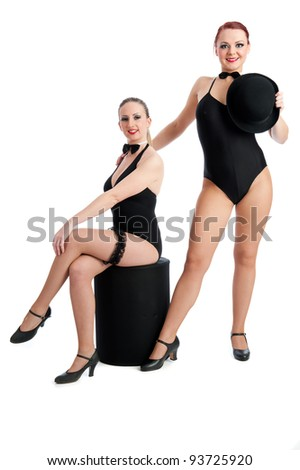 Two pretty female dancers isolated against white