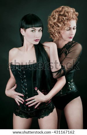 two pretty girls in corsets