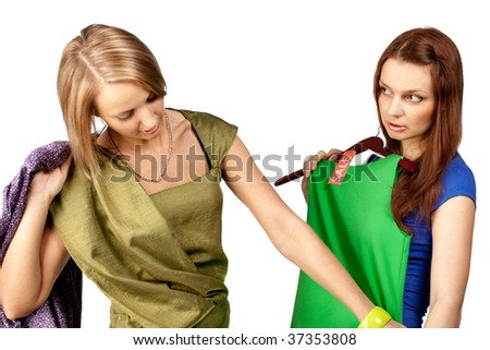 Two pretty girls with purchases on a white background