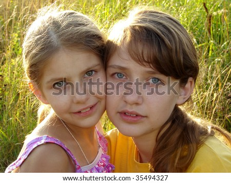 two pretty sisters summer outdoor portrait - stock photo