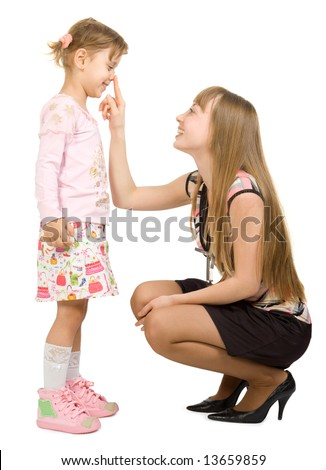 Two pretty smiling girls big girl touch nose little girl - stock photo