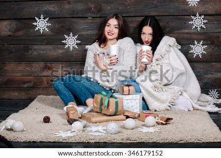 Two pretty young funny girls friends hugs smiling and cuddle together - stock photo