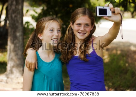 two pretty young girls posing for a picture - stock photo