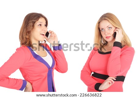 two pretty young girls speaking by mobile phone