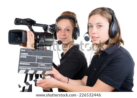 two pretty young women work with a video camera - stock photo