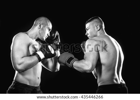 Two professional boxer isolated on black background, black and white photography - stock photo