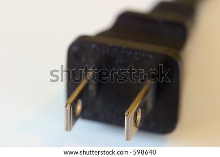 Two prong electrical plug, macro with shallow dof. - stock photo