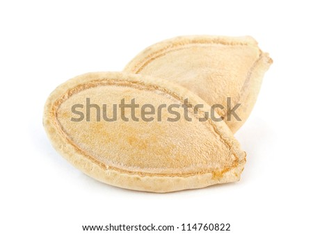 Two pumpkin seed on white - stock photo
