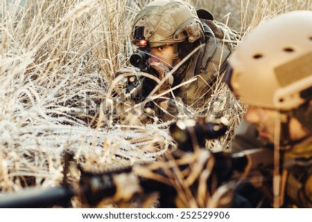 two rangers in an ambush aim at the enemy - stock photo
