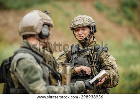 two rangers on the Outdoor of looking at the map