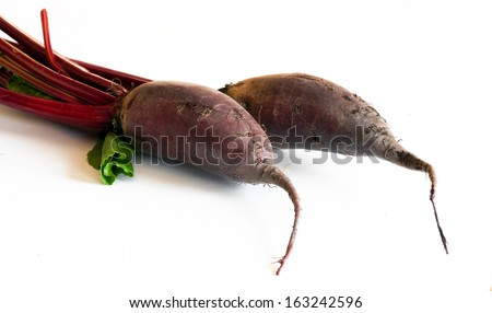 two raw beet roots  - stock photo
