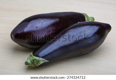 Two raw Eggplants on the wood background - stock photo