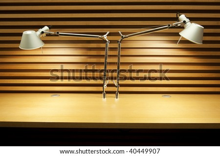Two reading lamps in empty desktop - stock photo