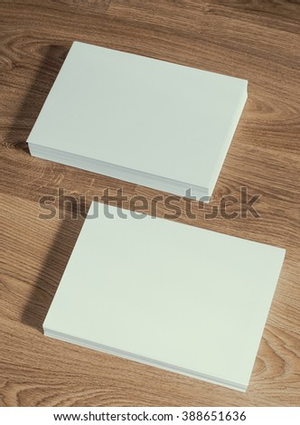 Two ream of paper on a wooden ground, vertical - stock photo