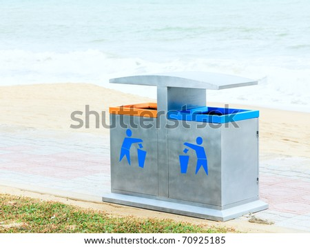 Two recycling bin on the beach. Environmental protection - stock photo