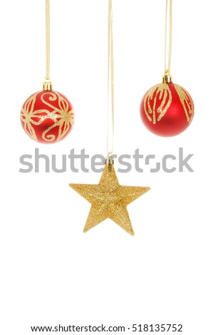 Two red and gold Christmas baubles with a gold glitter star isolated against white