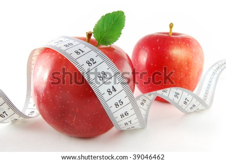 Two red apples with a tape on the white background