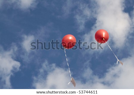 two red balloons in the sky, copy-space, room for text - stock photo