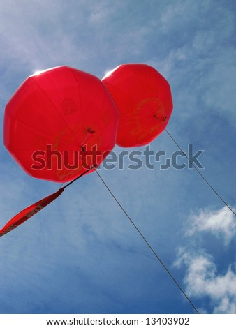 Two red Chinese balloons in the sky, concept of eternity and freedom - stock photo