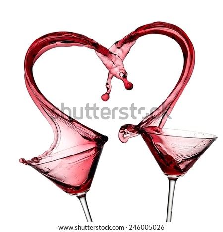 Two red cocktails heart splash - stock photo