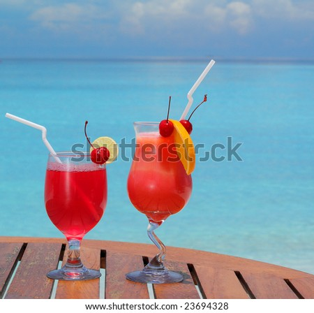 two red cocktails on the beach