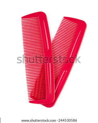 two red combs for hair isolated on white - stock photo