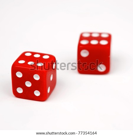 Two red dice isolated on white background - stock photo