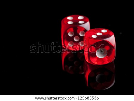 Two red dice on black background - stock photo