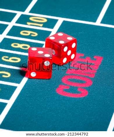 Two red dice on green gambling game gamble concept - stock photo