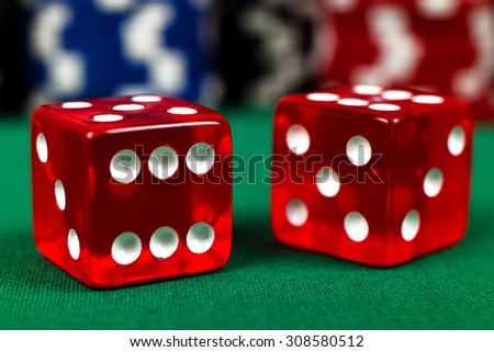 two red dice on green table, close up - stock photo