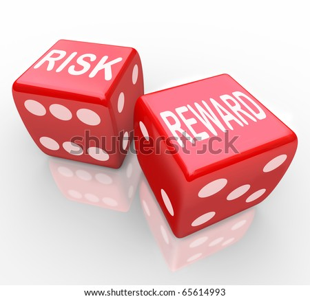 Two red dice with the words Risk and Reward symbolizing taking a chance on a new opportunity - stock photo