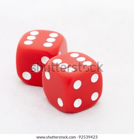 Two red dices with six on the top on clear background