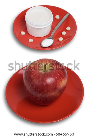 Two red dishes, one with red apple and second with the pills, medical cream, spoon with medicine powder. Top view. Isolated on white background with paths.
