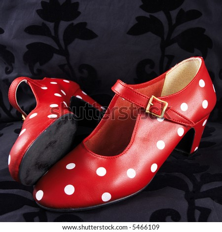 two red flamenco dancing shoes with white dots (black background) - stock photo