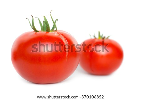 Two red fresh tomatoes isolated on white background - stock photo