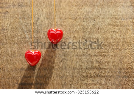 two Red heart background, old wood. - stock photo