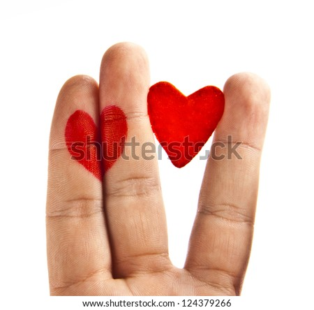 two red  heart painted on two fingers of divorced