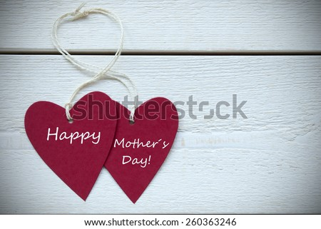 Two Red Hearts Label With White Ribbon On White Wooden Background With English Text Happy Mothers Day Vintage Retro Or Rustic Style With Frame - stock photo