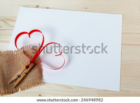 Two red hearts made of paper on a wooden background - stock photo