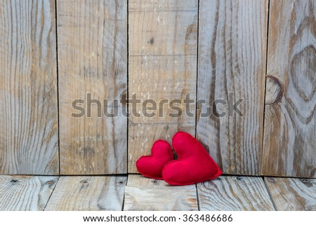 two red hearts on a wooden background for Valentine's Day - stock photo