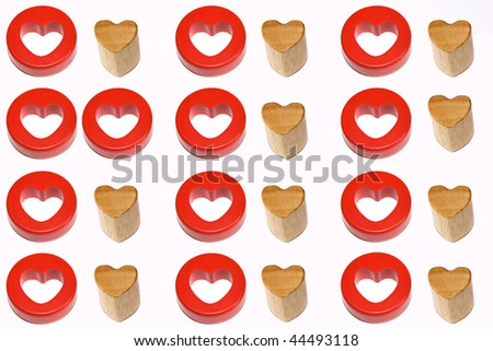 Two red hearts on an image with red and wooden couples - stock photo