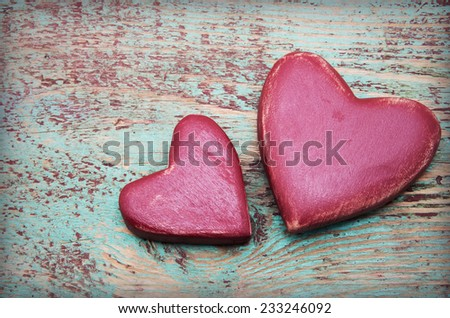 Two red hearts on old shabby wooden background - stock photo