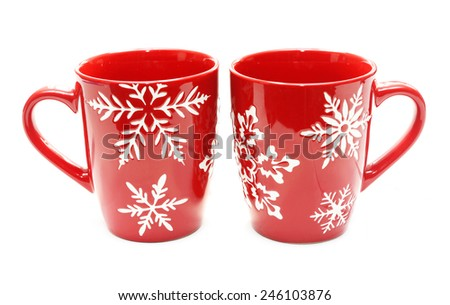 Two red mugs isolated on white