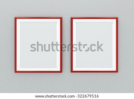 Two red picture frames over grey wall - stock photo