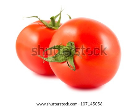 Two red ripe tomatoes isolated on white background
