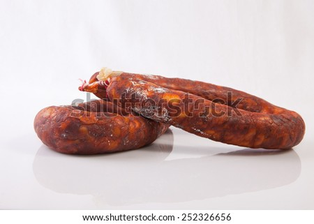 Two red spanish chorizos. Isolated over white background - stock photo