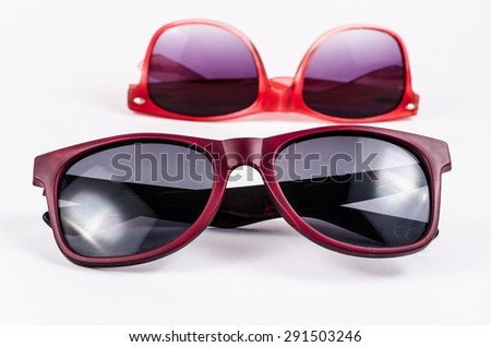 Two red sunglasses isolated on white background